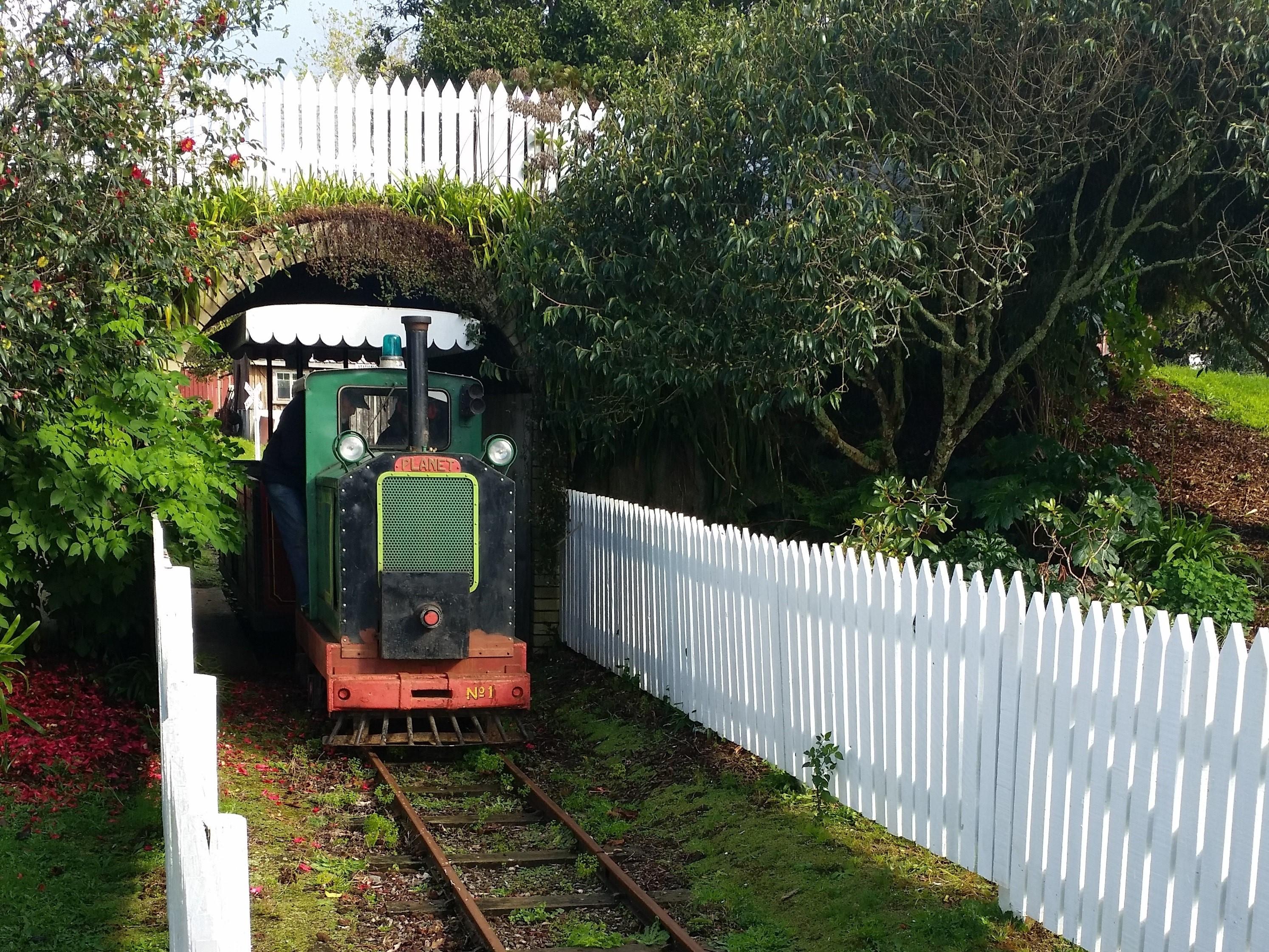 Pioneer Village Kaikohe's Planet Locomotive On Tracks Exiting A Tunnel