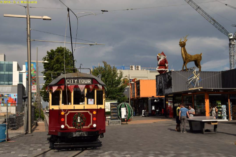 "Photo of the month.  David Maciulaitis recently posted this picture related to the festive season. Taken in the ""Re-Start"" mall in Cashel Street, Christchurch. Showing a decorated tram and the ""temporary"" containers which have been operating since October 2011 following the February 2011 earthquake. Note the table tennis table in place."